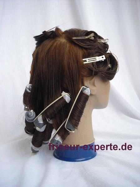 Übungskopf mit Einlegetechniken für kreative Hochsteckfrisur – Vorschlag für Friseurprüfung